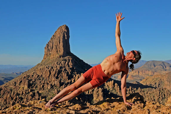 Man doing Yoga Pose at Weavers Needle